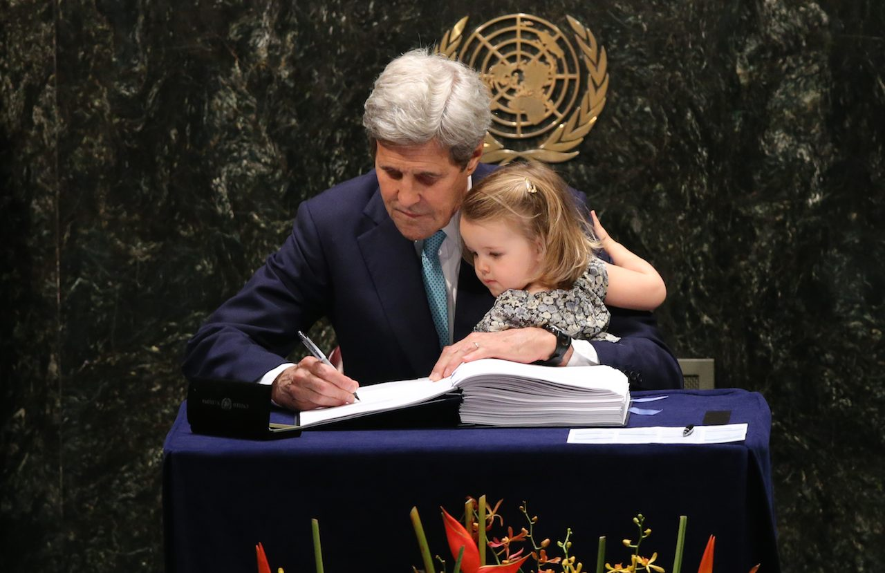 SIGNED. US Secretary of State John Kerry (L) holds his granddaughter Isabelle Dobbs-Higginson after signing the Paris Aggrement at the High-Level Event for the Signature of the Paris Agreement at the United Nations Headquarters in New York, New York, USA, 22 April 2016. Photo by Andrew Gombert / EPA