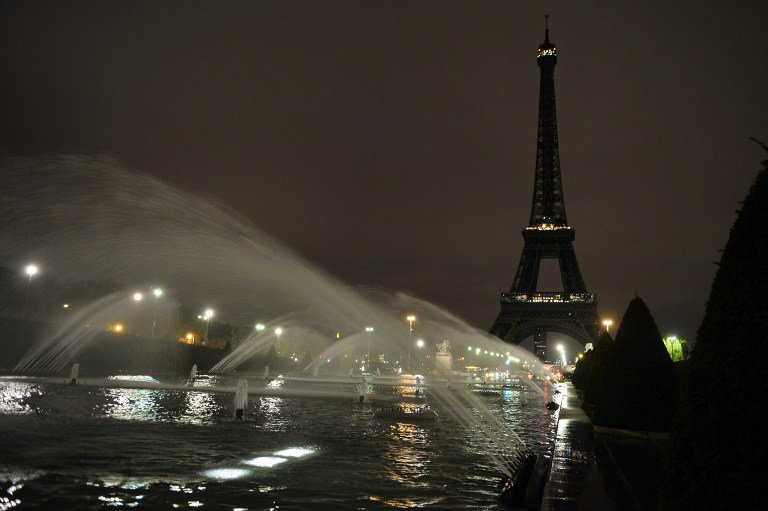 MOURNING CITY. A picture taken on November 14, 2015 shows the Eiffel Tower with its lights turned off following the deadly attacks in Paris. Islamic State jihadists claimed a series of coordinated attacks by gunmen and suicide bombers in Paris that killed at least 129 people. Photo by Alain Jocard/AFP