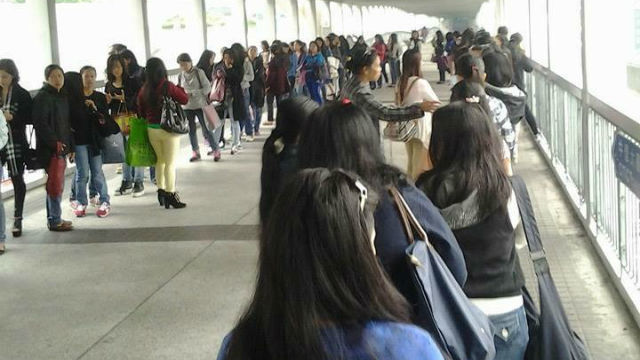 LONG LINES. OFWs in Hong Kong line up for hours to obtain their Overseas Employment Certificates. Photo by Daisy CL Mandap/The Sun-HK
