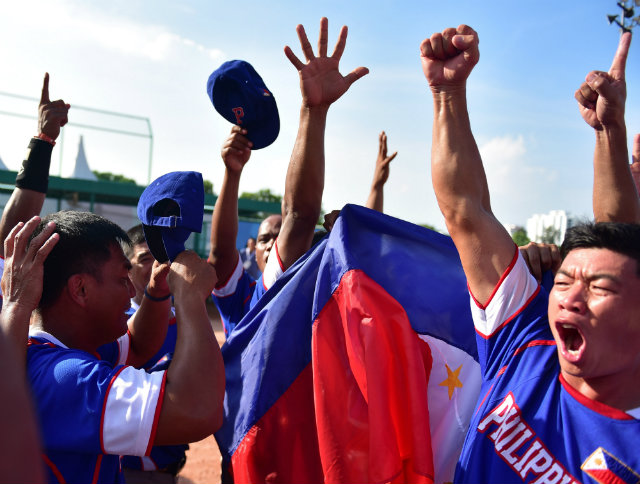 The Philippine men's softball team topped Thailand to win gold. Photo by Singapore SEA Games Organising Committee/Action Images via Reuters