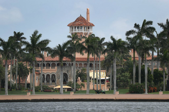 THREAT? Reports indicate that at over the past weekend a woman from China was arrested and found to be carrying four cellphones and a thumb drive infected with malware after she made her way into the resort during President Trumps visit. Photo by Joe Raedle/Getty Images/AFP