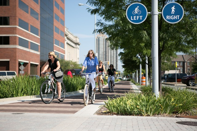 INDEPENDENT IN INDIANAPOLIS. Protected lanes encourage women to hop on the bike saddle. Photo courtesy of PeopleForBikes