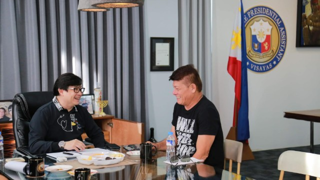 Rico's Lechon owner Enrico Dionson meets with Presidential Assistant for the Visayas Mike Dino. Photo from the Office of the Presidential Assistant for the Visayas.