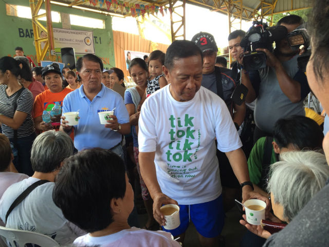 FROM THE VP'S HANDS. Binay handing out porridge among senior citizens in Caloocan City.