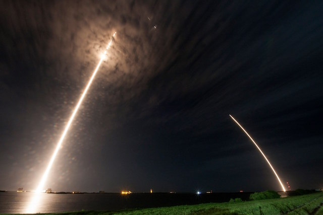 DRAGON AND FALCON. A multiple exposure photo showing the trail of the Dragon spacecraft as it lifts off, with the Falcon 9 rocket's trail as it landed, at Cape Canaveral, Florida, July 18, 2016. File photo courtesy SpaceX