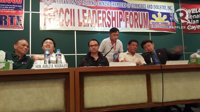 MEN OF DAVAO. Davao City 1st District Representative Karlo Nograles and Davao City Mayor Rodrigo Duterte sit at the same table during a forum with Filipino-Chinese businessmen.