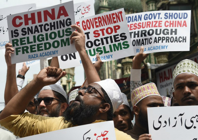 INJUSTICE. Indian Muslims hold placards during a protest against the Chinese government over the detention of Muslim minorities in Xinjiang. File photo by Punit Paranje/AFP