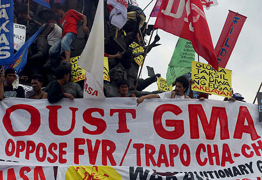 EDSA 2. Filipino activists mass in front of the People Power Monument on January 20, 2006, for the 5th anniversary of the People Power revolt that ousted former President Joseph Estrada. This time, they are demanding the ouster of Gloria Arroyo. Photo by Mike F. Alquinto/EPA