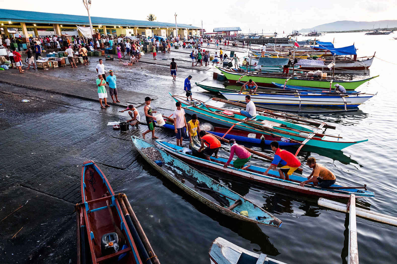 AFTER A HARD DAY'S WORK. Municipal fishers at the fish landing in Mercedes, Camarines Norte. Photo courtesy of Jason Houston/Rare