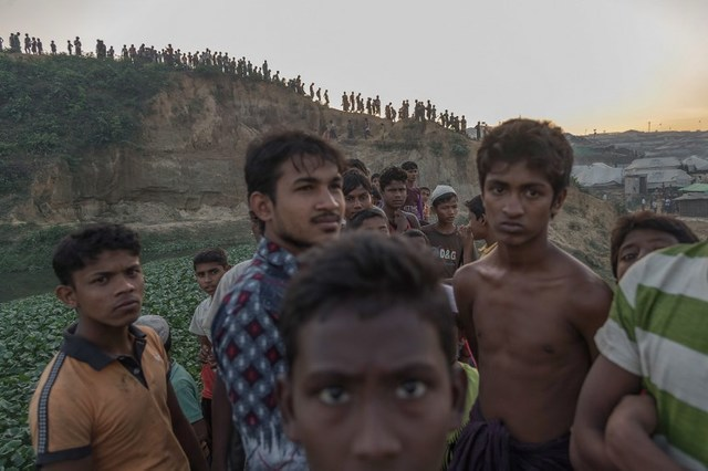 ROHINGYA. This picture taken on November 26, 2017 shows Rohingya Muslim refugees looking on near Kutupalong refugee camp in Cox's Bazar, Bangladesh. File photo by Ed Jones/AFP