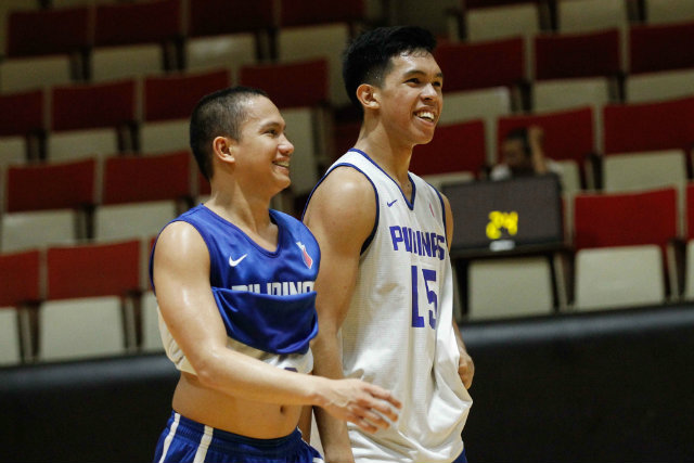Almond Vosotros (L) of De La Salle University and Thirdy Ravena (R) of Ateneo share a laugh. Photo by Czeasar Dancel