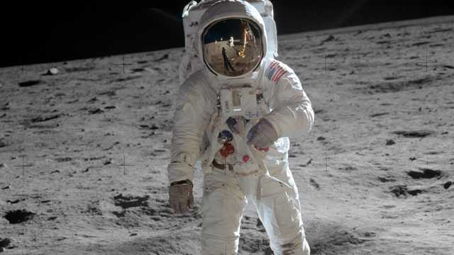 US Astronaut Edwin u0022Buzzu0022 Aldrin is shown walking near the Lunar Module 20 July 1969 during the Apollo 11 space mission. Visible as a reflection in Aldrin's visor is Neil Armstrong, the man who took the photo. Photo by NASA