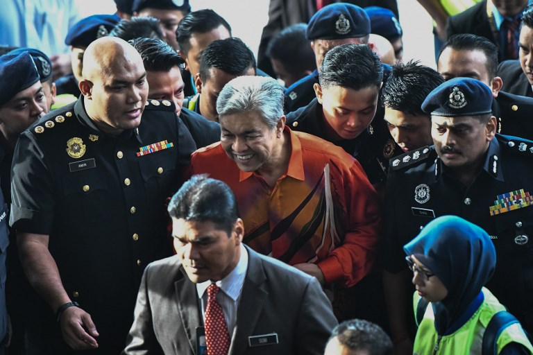 DETAINED. Malaysia's deputy former prime minister Ahmad Zahid Hamidi is escorted by police to a court in Kuala Lumpur to face charges on October 19, 2018. Photo by AFP