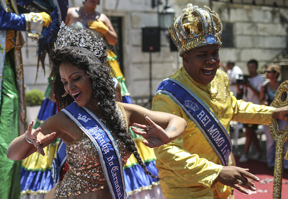 FESTIVITIES. The King Momo (R), dances with the Queen of the Carnival after receiving the Keys of the City, which represents the official opening of the Carnival of Rio. Photo by Antonio Lacerda/EPA