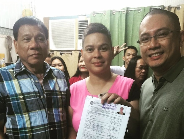 PRESIDENTIAL IN-LAW. Lawyer Manases Carpio (right) with wife, Sara, and President Rodrigo Duterte in 2016. File photo from the Facebook page of Manases Carpio