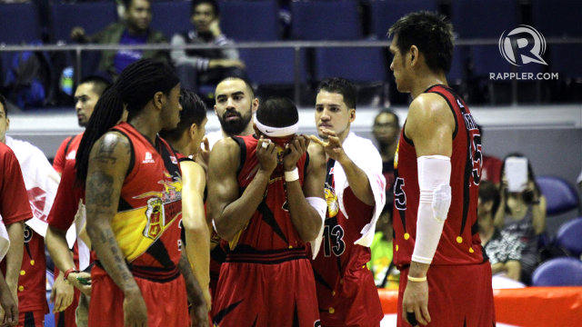 San Miguel Beer players try to comfort a visibly distraught Arwind Santos after his mother was stretchered off the court. Photo by Josh Albelda/Rappler