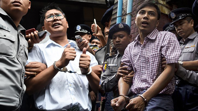 JAILED. The two Reuters journalists face 7 years in prison after allegedly obtaining classified documents illegally. Wa Lone photo by Ye Aung Thu/AFP, Kyaw Soe Oo photo by Aung Kyaw Htet/AFP.