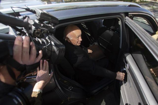 RESIGN. Santiago's Archbishop Ricardo Ezzati leaves after declaring at the public prosecutor's office for alleged cover-up of sex abuse in Rancagua, Chile. File photo by Claudio Reyes/AFP