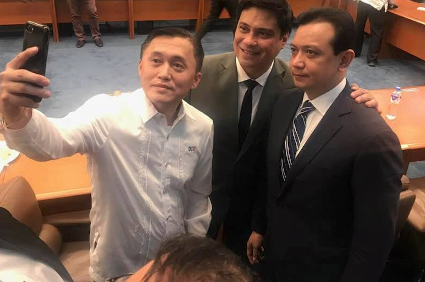 SELFIE. Special Assistant to the President Bong Go takes a selfie with one of his boss' fiercest critics, opposition Senator Antonio Trillanes IV. Photo by Camille Elemia/Rappler