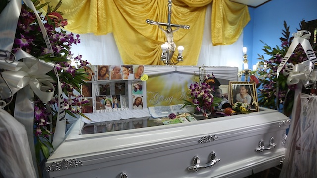 SLAIN TEEN. Photos of the teenager are placed on top of Charlie Jean Du's casket