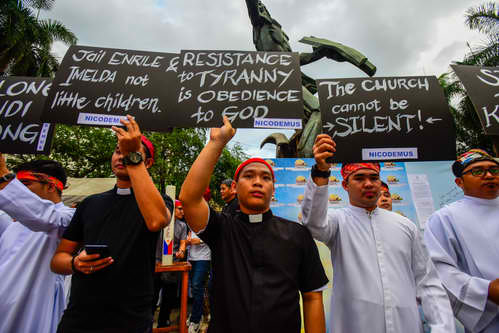BREAK THE SILENCE. 'Resistance to tyranny is obedience to God,' reads a poster at an interfaith rally in Manila on January 25, 2019. Photo by Maria Tan/Rappler