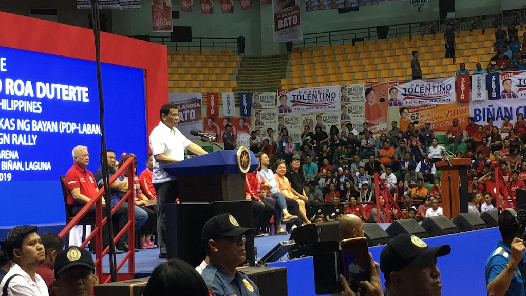LAGUNA. In a rally in Biu00f1an, I was seated near the stage, Malacau00f1ang officers, and President Duterte. Photo by Camille Elemia/Rappler
