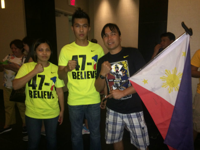 Jhonele (C) and his friends show their support for Manny Pacquiao at the Delano Hotel. Photo by Ryan Songalia