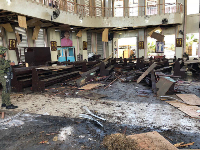 AFTERMATH. Inside the Jolo Cathedral in the aftermath of the blast. Photo from AFP Westmincom