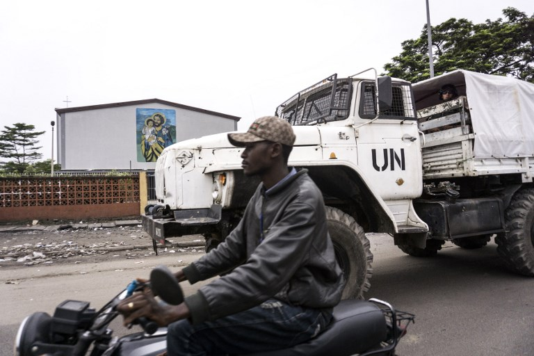 UNREST. A United Nations Peacekeepers truck patrols around Catholic churches during a demonstration calling for the President of the Democratic Republic of the Congo (DRC) to step down on January 21, 2018 in Kinshasa. Photo by John Wessels/AFP