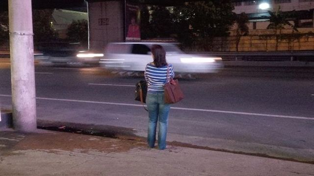 WAITING FOR THE BUS. Camarines Sur Representative Leni Robredo waits for a Naga-bound bus at the Magallanes Shell Station in December 2014. Photo from Leni Robredo's Facebook page