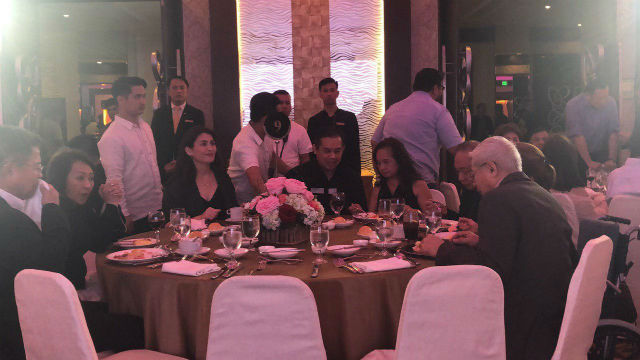 VIP TABLE. Romualdez sits beside his wife Tingog Representative Yedda Romualdez (3rd from L) and their ally, former president and speaker Gloria Macapagal Arroyo (3rd from R). Photo by Mara Cepeda/Rappler
