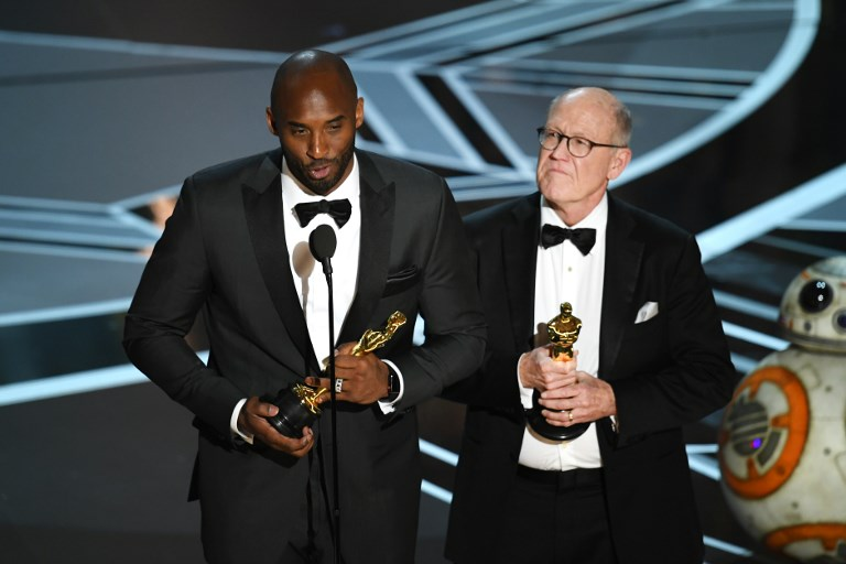 OSCAR WINNER. Filmmakers Kobe Bryant (left) and Glen Keane accept Best Animated Short Film for 'Dear Basketball' onstage during the 90th Annual Academy Awards at the Dolby Theatre at Hollywood u0026 Highland Center on March 4, 2018 in Hollywood, California. Photo Kevin Winter/Getty Images/AFP