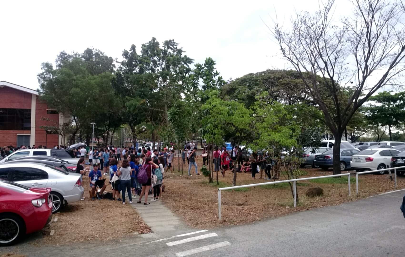 EMERGENCY. Students, faculty, and staff assembling outdoors during an evacuation at the Ateneo de Manila University campus, March 28, 2016. Photo courtesy of Jose Adrian Dalangin