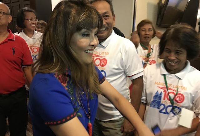 EARLY START. Barangay officials dressed in 'Marcos Latta (Marcos Pa Rin)' welcome Imee Marcos during her visit to the 15th Liga ng Mga Barangay -Cagayan Congress in Clark, Pampanga.u00a0Photo by Raymon Dullana/Rappler