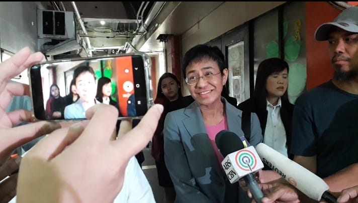 DISMISS IT. Rappler CEO and executive editor Maria Ressa outside a Manila court in February 2019. File photo by Lian Buan/Rappler