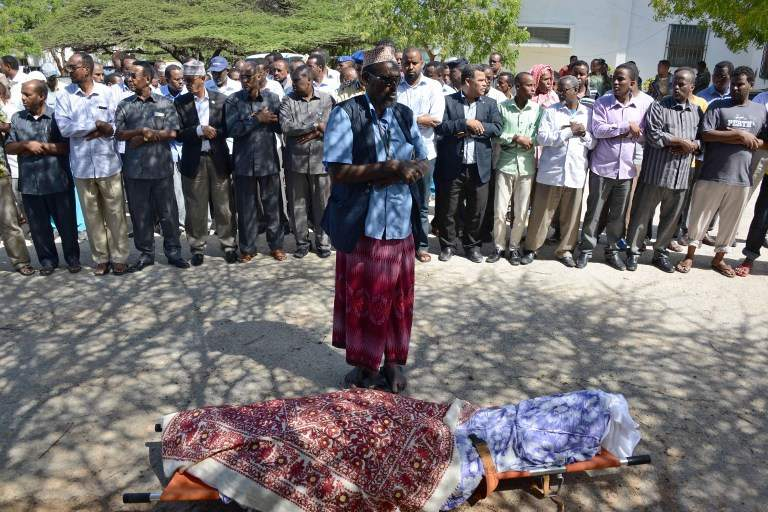 ASSASSINATION. Somali MP's pray over the body of slain Somali lawmaker Ahmed Mohamud Hayd during his funeral June 3, 2014 in Mogadishu. Photo by Mohamad Abdiwahab / AFP