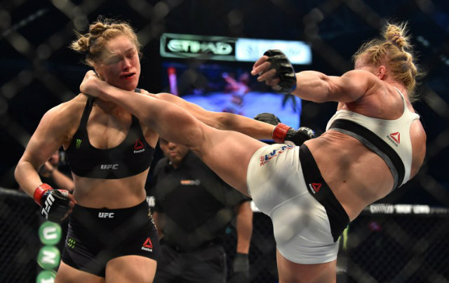 KO. Holly Holm lands the deadly left kick to Ronda Rousey's face en route to the one-sided knockout win. Photo by Paul Crock/AFP