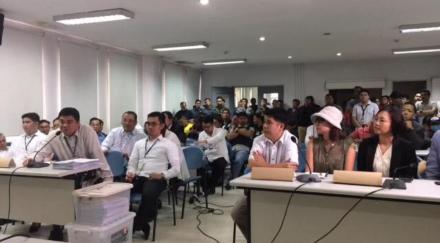 Mario Dionisio (on the left side, speaking through the microphone) of the Public Attorneys Office appeals to the Department of Justice (DOJ) panel to spare them the cost of photocopying documents. Photo by Lian Buan/Rappler