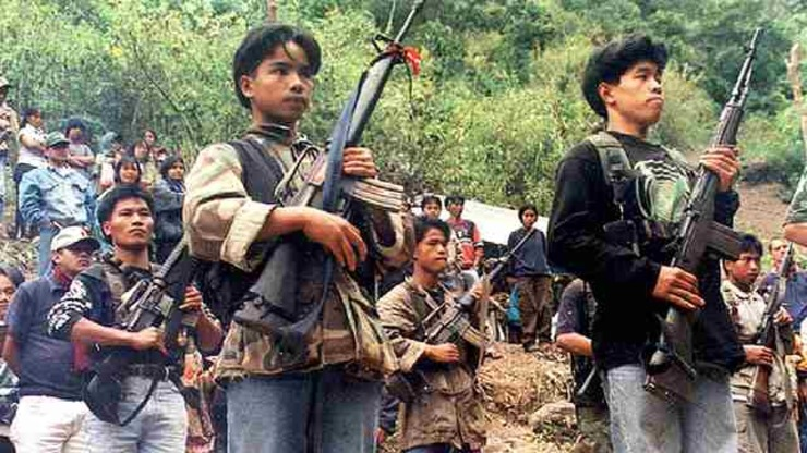 PEACE TALKS SOON?. Picture dated 29 March 2002 shows NPA guerrillas at a clandestine assembly in the Cordillera region in northern Philippines. File photo by Agence France-Presse