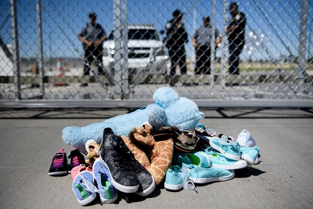 CHILDREN'S FATE. This June 21, 2018 file photo shows security personal standing before shoes and toys left at the Tornillo Port of Entry in Tornillo, Texas where minors crossing the border without proper papers have been housed after being separated from adults. File photo by Brendan Smialowski/Agence France-Presse