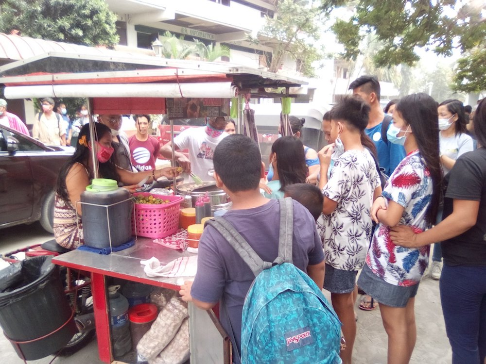 In Sto. Tomas, Batangas, street vendors decide to give up a day of their income to feed the evacuees at the Polytechnic University of the Philippines. Photo by Twitter user @big_bryte