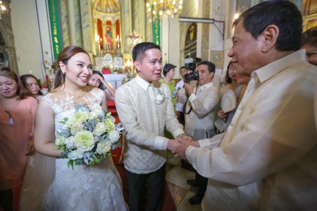 GODFATHER. President Duterte is principal sponsor at the wedding of Waldo and Regine Carpio in September 2016 in Intramuros, Manila. Presidential photo