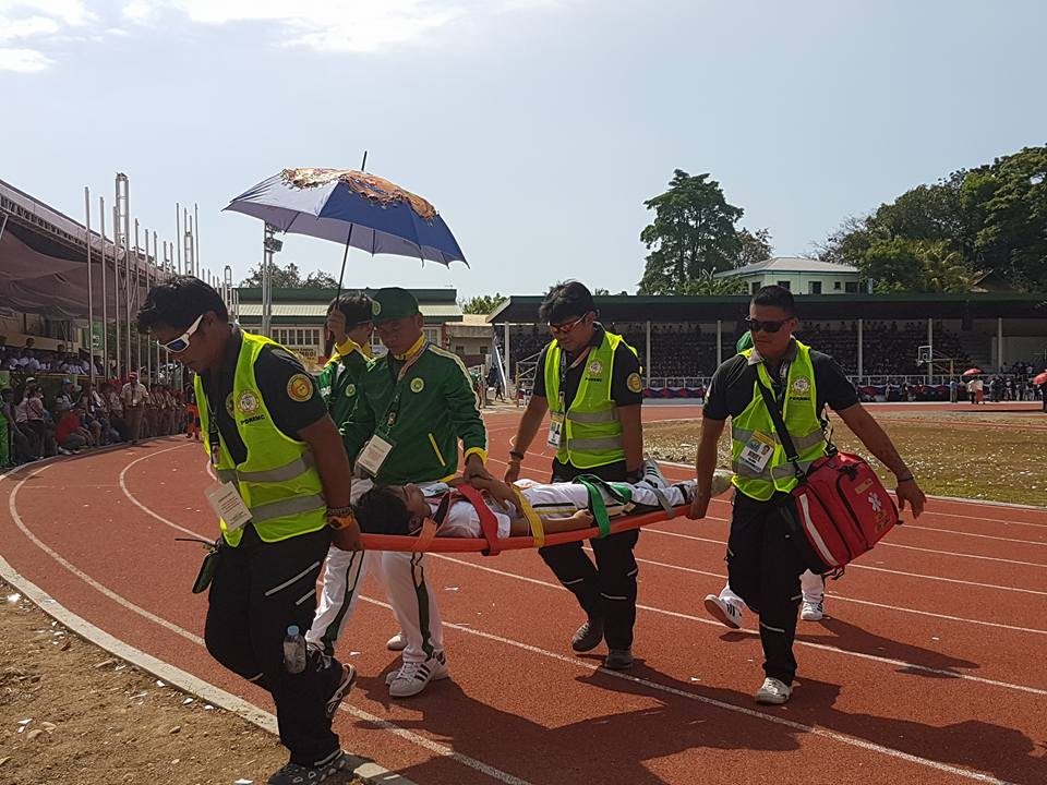 PALARO HEAT. Medics carry a delegate from Eastern Visayas after he passed out due to the scorching heat during the Palarong Pambansa 2017 opening at the Binirayan Stadium, Antique. Photo by Mark Rich Pablo/ Palaro Mover,NCR