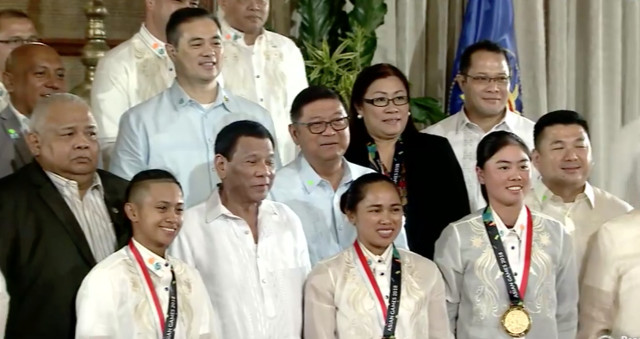 GOLDEN GIRLS. President Duterte poses for a photo with Asian Games gold-medal winners Hidilyn Diaz of weigthlifting, skateboarding's Margielyn Didal, golf's Yuka Saso. RTVM screenshot