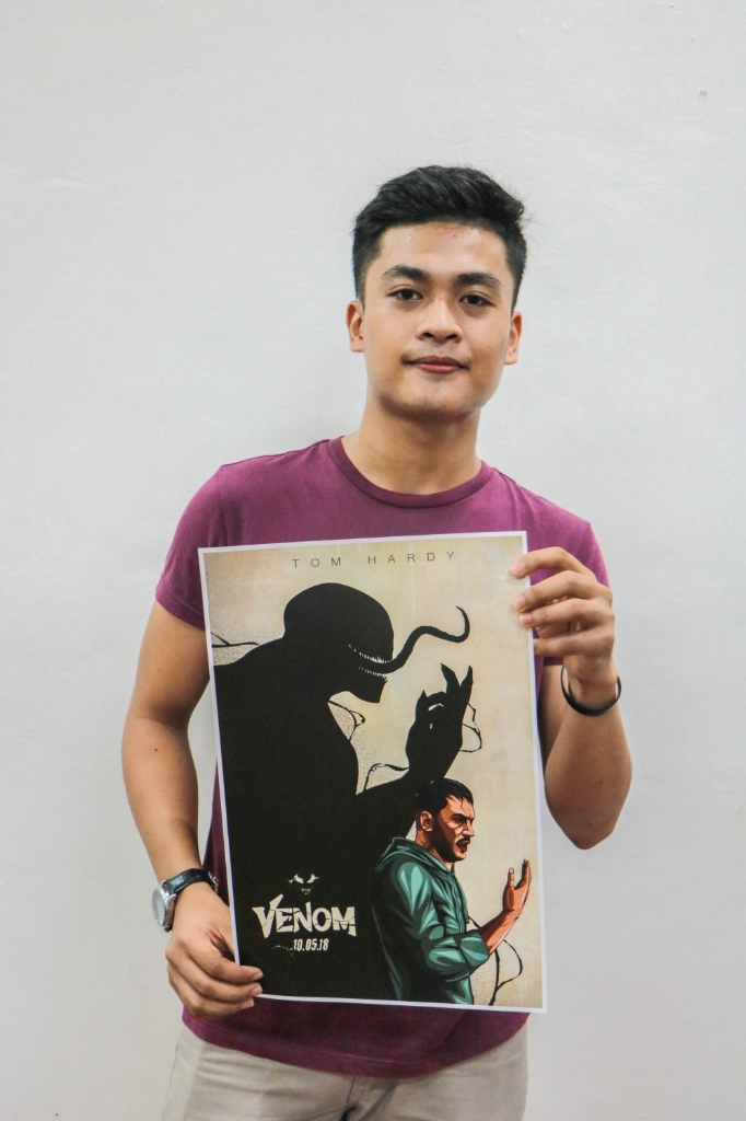 CONGRATS JEUZ! 22-year-old Jeuz Sumangil holding one of the five winning alternative 'Venom' posters. Photo courtesy of Columbia Pictures
