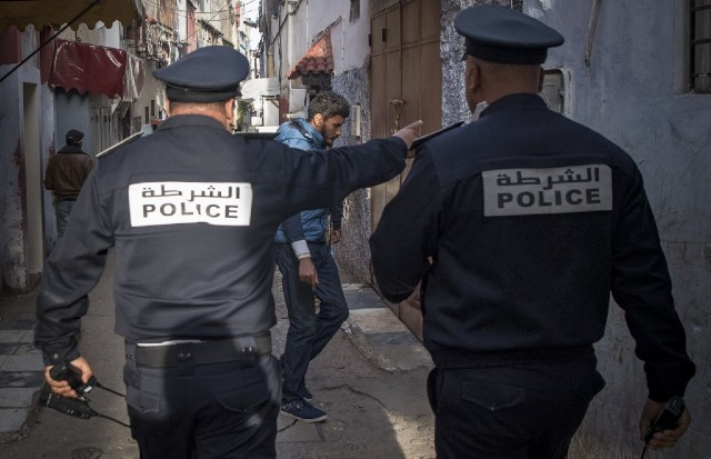 GO HOME. Moroccan policemen, patrolling as part of a larger combined security force, instruct people to return to and remain at home as a measure against the COVID-19 coronavirus pandemic in the capital Rabat's district of Takadoum. Photo by Fadel Senna/AFP