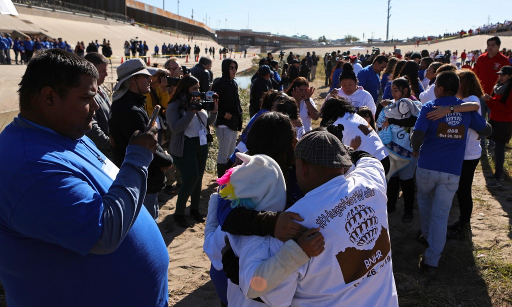 REUNITED. Mexican families separated by the border wall are reunited for 3 minutes in the 7th edition of the Hugs Not Walls event organized by the Border Network for Human Rights, in front of the border wall on the Rio Grande in Ciudad Juarez, Chihuahua state, Mexico on October 26, 2019. Photo by Herika Martinez/AFP