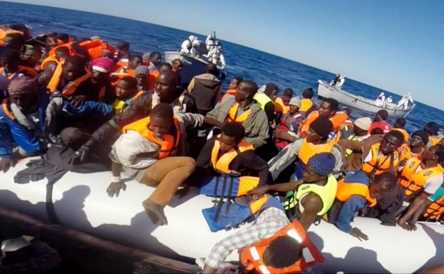 RESCUED. This handout video grab released by the Italian Coast Guard (Guardia Costiera) on May 2, 2015 shows some of 220 shipwrecked migrants being rescued by the Italian coast guard, on May 1, 2015, in the Mediterranean Sea, off the coast of Sicily. Photo from Guardia Costiera/AFP