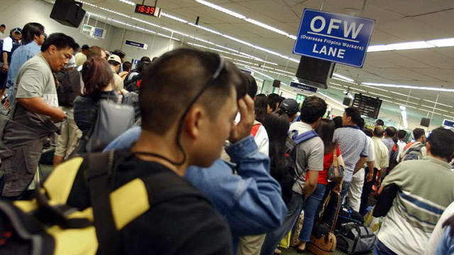 BILL FOR OFWS. A bill filed in the 17th Congress seeks to lessen red tape for OFWs. File photo by Rappler