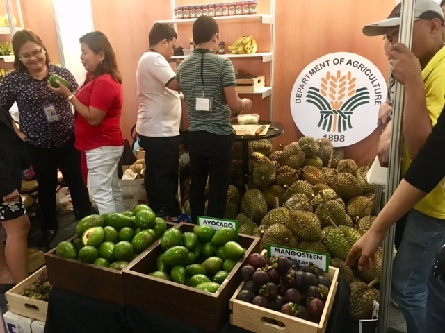 FRESH FRUITS. A booth of the Department of Agriculture in IFEX 2018 showcases mangosteen, avocado, and durian. Photo by Ralf Rivas